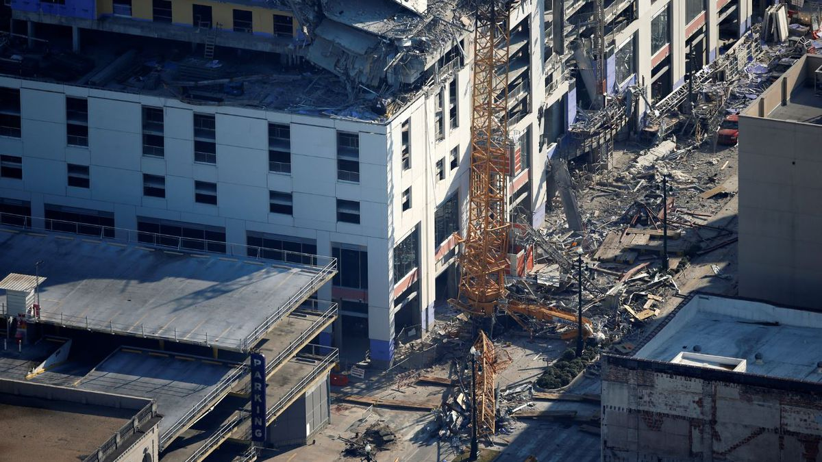 One of two large cranes from the Hard Rock Hotel construction collapse is seen on Rampart Street, in this aerial photo after they cranes were detonated for implosion in New Orleans, Sunday, Oct. 20, 2019. | Source: AP Photo / Gerald Herbert