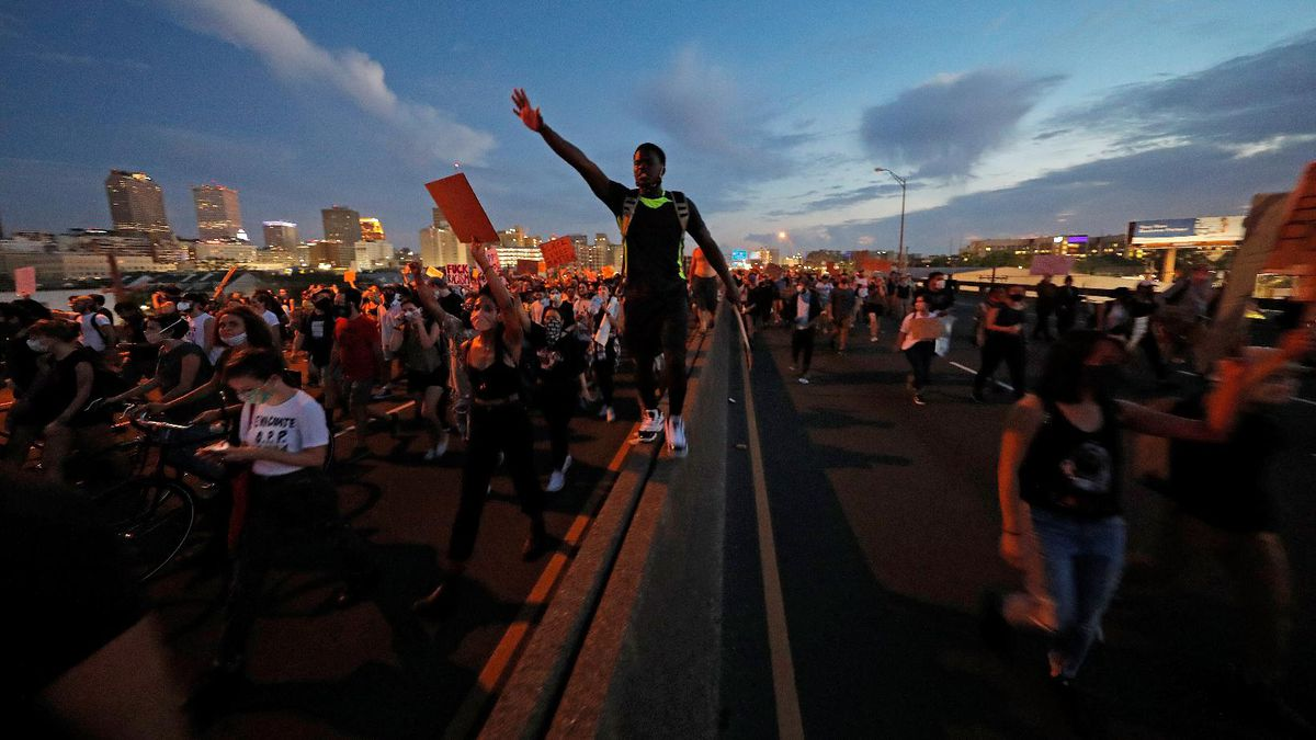 Protesters take over the elevated Interstate 10 during a march in New Orleans, Tuesday, June 2, 2020, protesting the death of George Floyd, who died after being restrained by Minneapolis police officers on May 25.