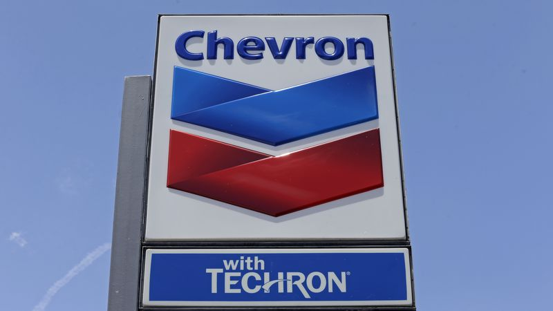 FILE - A Chevron sign at a gas station.