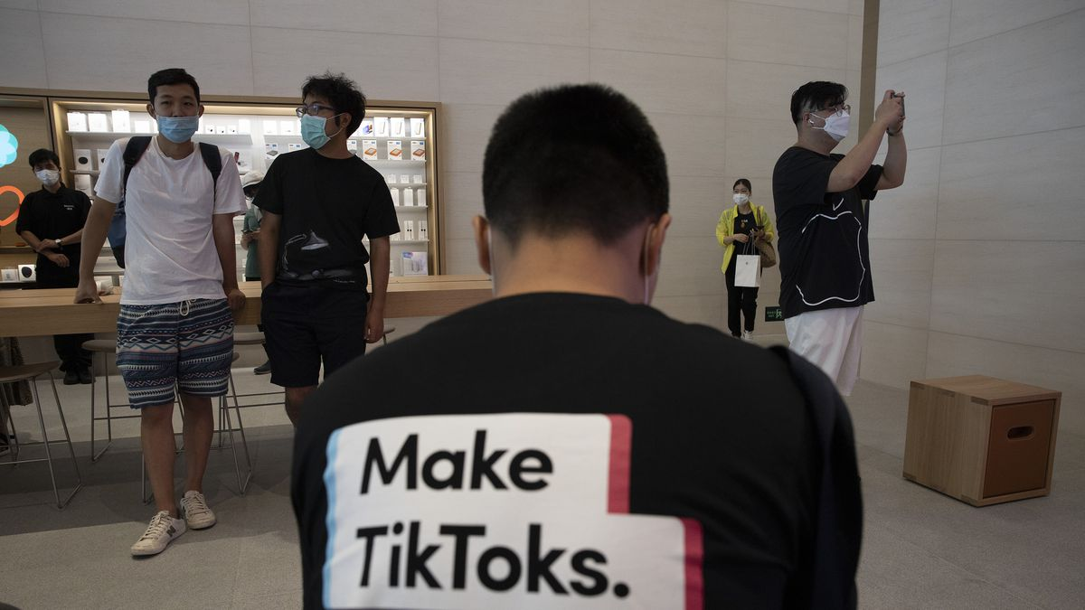A man wearing a shirt promoting TikTok is seen at an Apple store in Beijing on Friday, July 17,...