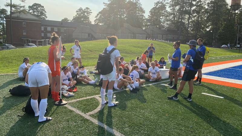 The Lady Wildcats celebrate a win against Central Baptist College.