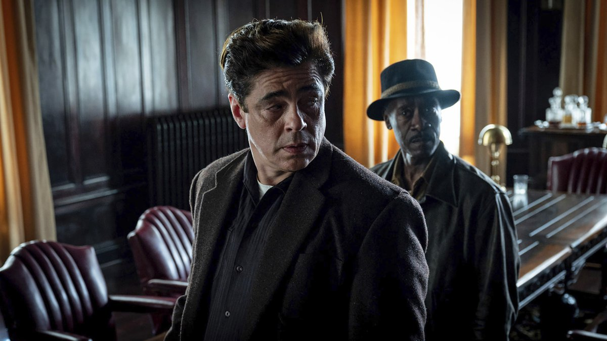 This image released by Warner Bros. Pictures shows Benicio del Toro, center, and Don Cheadle in...
