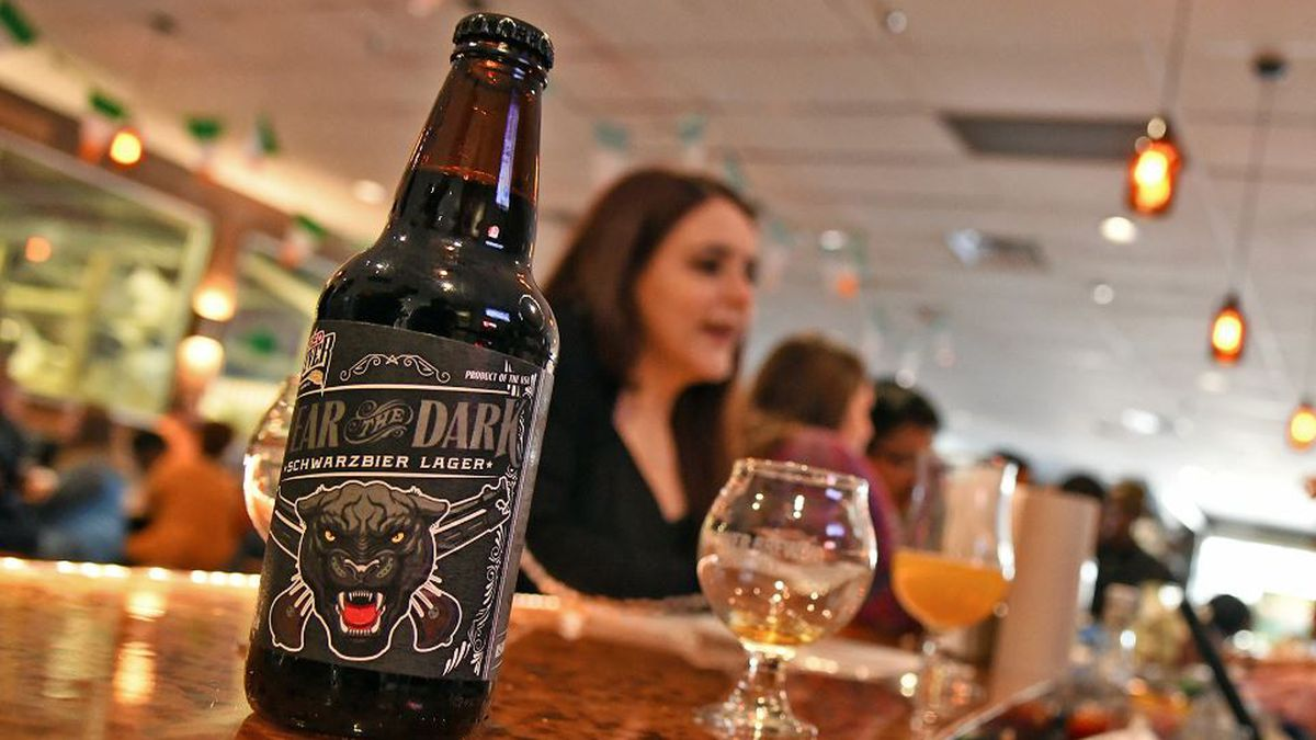 A bottle of Red River Brewing Company's Fear the Dark, a dark, refreshing German lager with notes of coffee and chocolate, sits on the brewery bar in Shreveport, Louisiana, March 16, 2019. RRBC brewed the beer to recognize the Louisiana National Guard's 39th Military Police Company, 773rd MP Battalion, 139th Regional Support Group's upcoming deployment to Guantanamo Bay, Cuba. (U.S. Army National Guard photo by Staff Sgt. Garrett L. Dipuma)