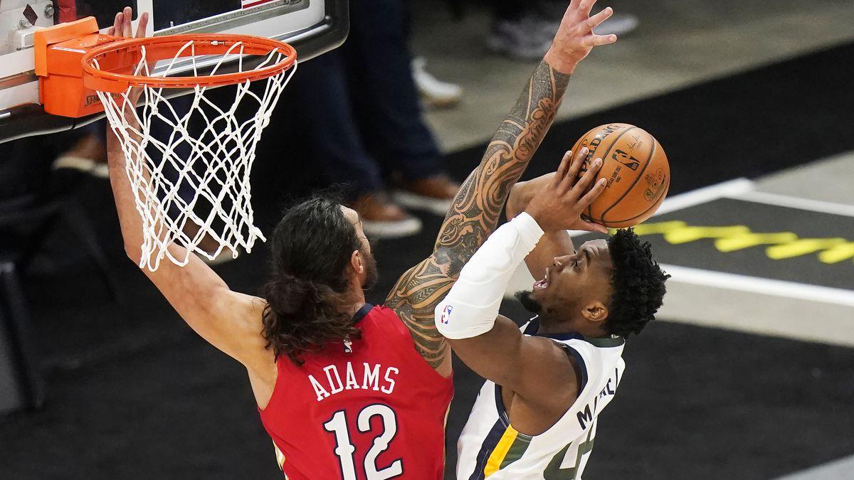 New Orleans Pelicans center Steven Adams (12) defends against Utah Jazz guard Donovan Mitchell...