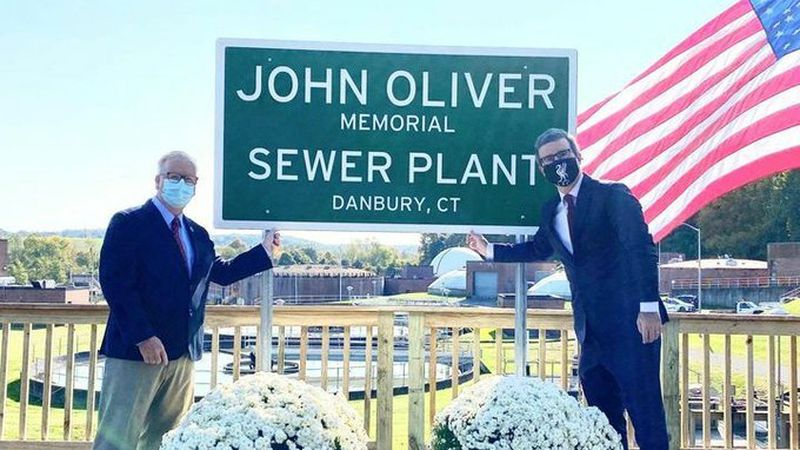 John Oliver made a secret trip to Connecticut last week to help cut the ribbon on a sign naming...