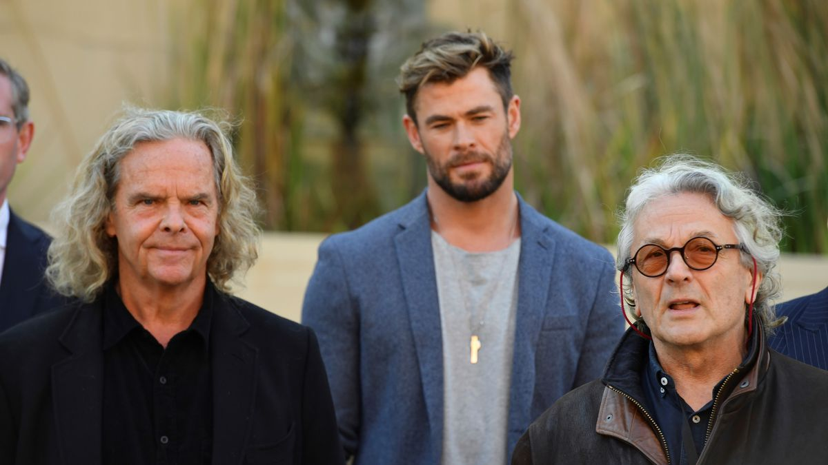 From left, Producer Doug Mitchell, actor Chris Hemsworth and director George Miller attend at a...