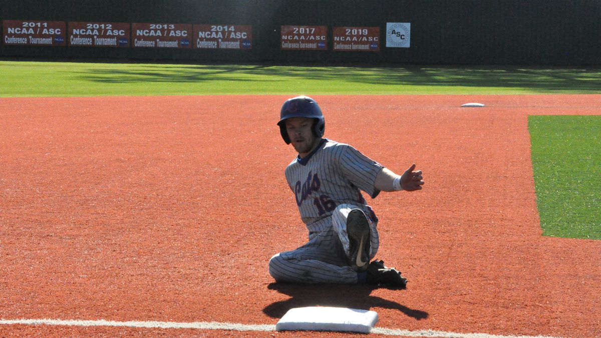 Sr. LF Christian Vandergrift sliding into third base Saturday against Alma. Credit: Darrell Brown/LC Sports Information