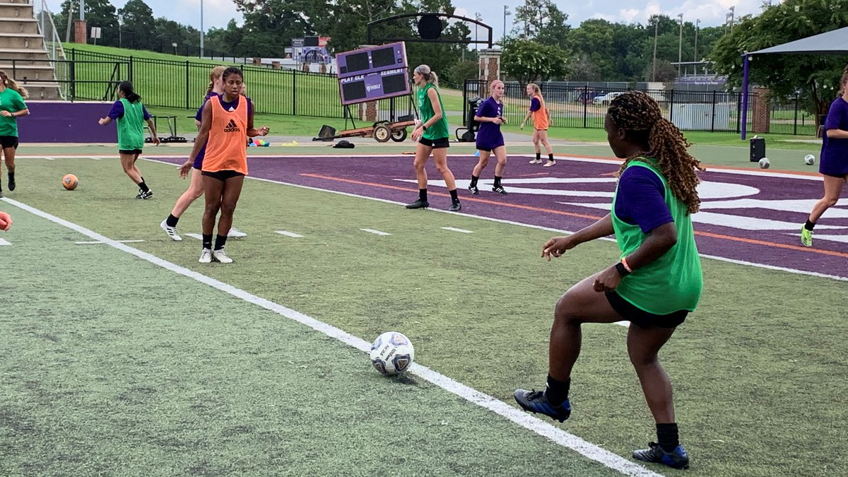 NSU senior Natalee Henry passes to Jalen Donaldson on Tuesday on soccer's opening day of fall...