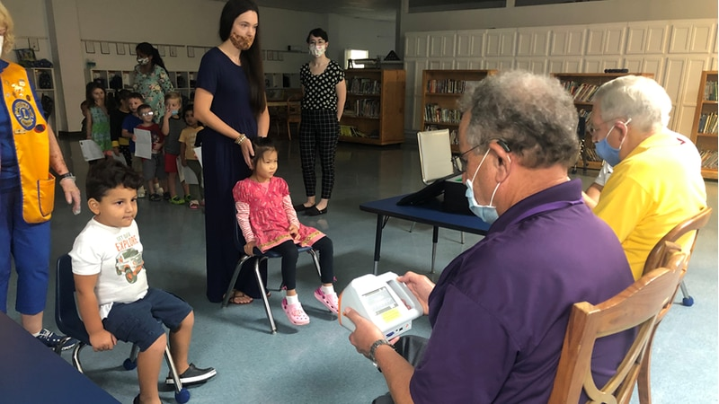 Eye tests being performed by members of the Alexandria Lions Club on Wednesday, October 6, 2021.