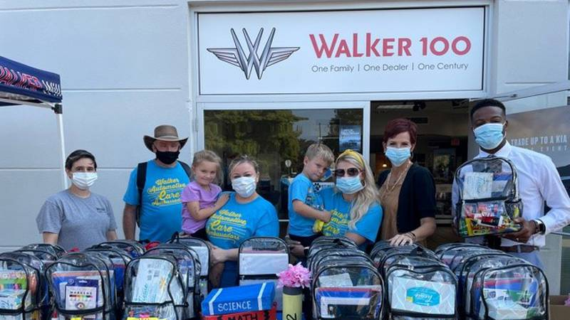 Walker Kia in Alexandria held a back-to-school event, giving away 100 backpacks filled with...