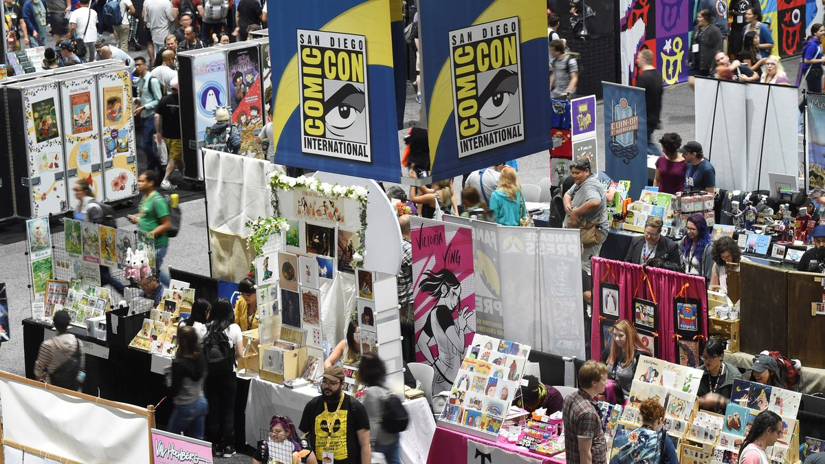 FILE - Comic-Con attendees walk the convention center floor during preview night at Comic-Con...