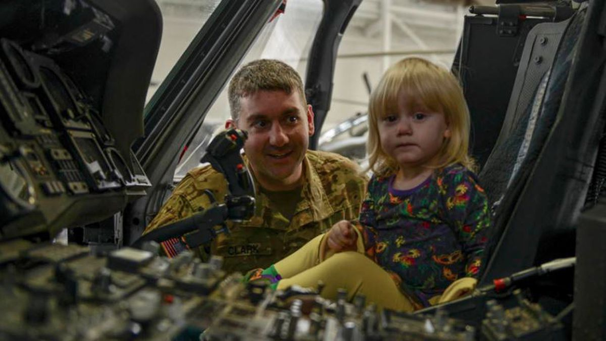 Louisiana National Guard Sgt. Curtis Clark, of Pineville, Louisiana, shows his daughter, Sophie, the cockpit of a UH-60 Blackhawk helicopter before a deployment ceremony at the Army Aviation Support Facility #2 at Esler Field in Pineville, Feb. 16, 2019. Clark and roughly 70 other Guardsmen with the 1st Assault Helicopter Battalion, 244th Aviation Regiment are set to deploy to various countries in the Middle East where they will provide air movement and medical evacuation support to ground forces. (U.S. Army National Guard photo by Sgt. Noshoba Davis)