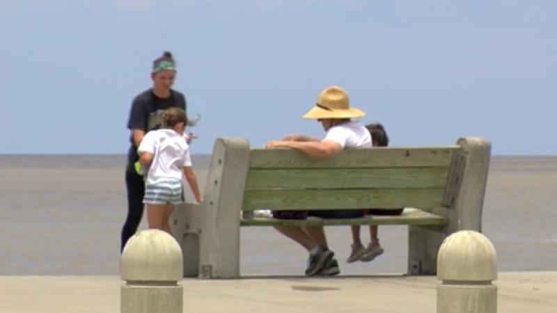 Families relax along Lake Pontchartrain as Memorial Day weekend begins.