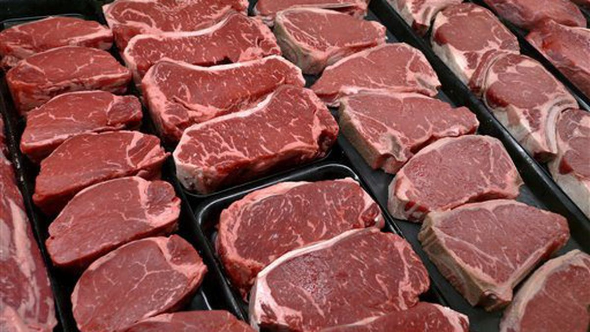 FILE - In this Jan. 18, 2010 file photo, steaks and other beef products are displayed for sale...