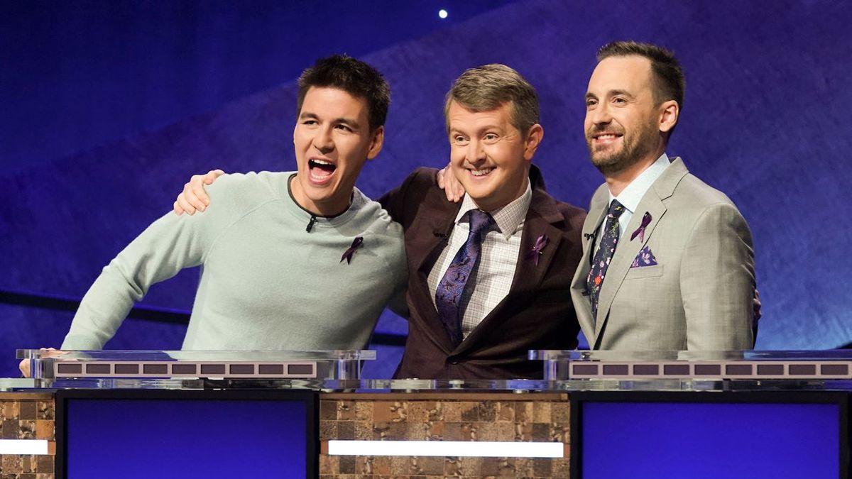 """In this image released by ABC, contestants, from left, James Holzhauer, Ken Jennings and Brad Rutter appear on the set of """"Jeopardy! The Greatest of All Time,"""" in Los Angeles. The all-time top """"Jeopardy!"""" money winners; Rutter, Jennings and Holzhauer, will compete in a rare prime-time edition of the TV quiz show which will air on consecutive nights beginning 8 p.m. EDT Tuesday. 