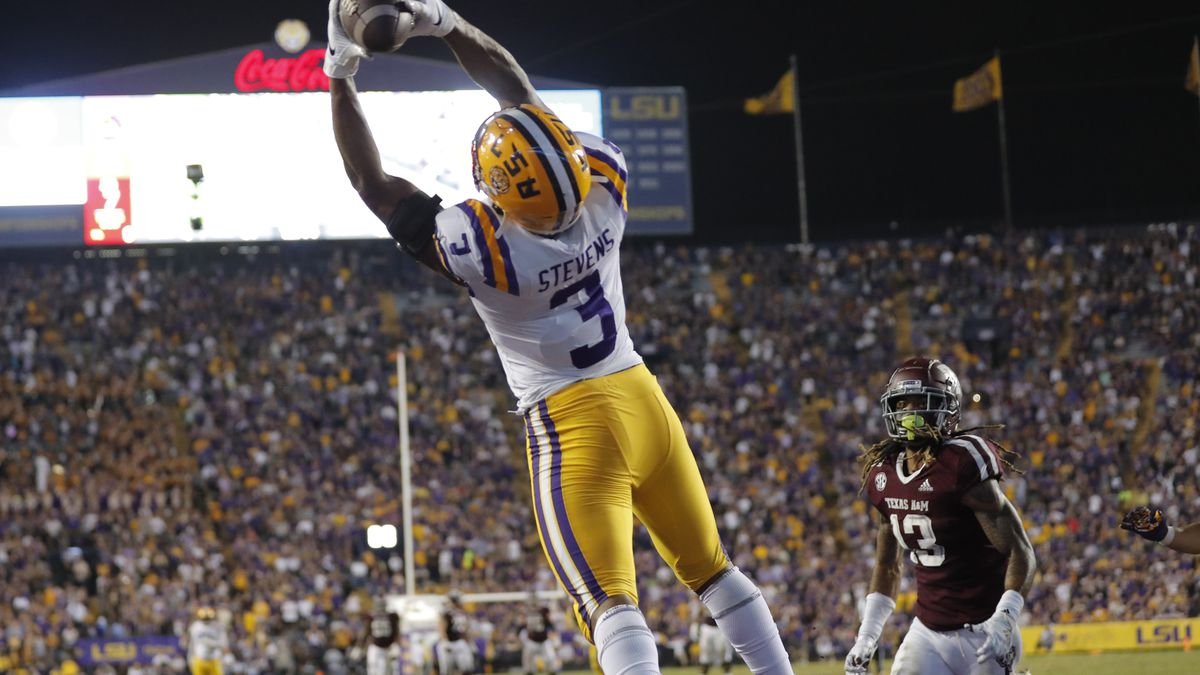 LSU safety JaCoby Stevens (3) pulls in an interception in the end zone on a pass intended for Texas A&M wide receiver Kendrick Rogers (13) during the second half of an NCAA college football game in Baton Rouge, La., Saturday, Nov. 30, 2019. LSU won 50-7.