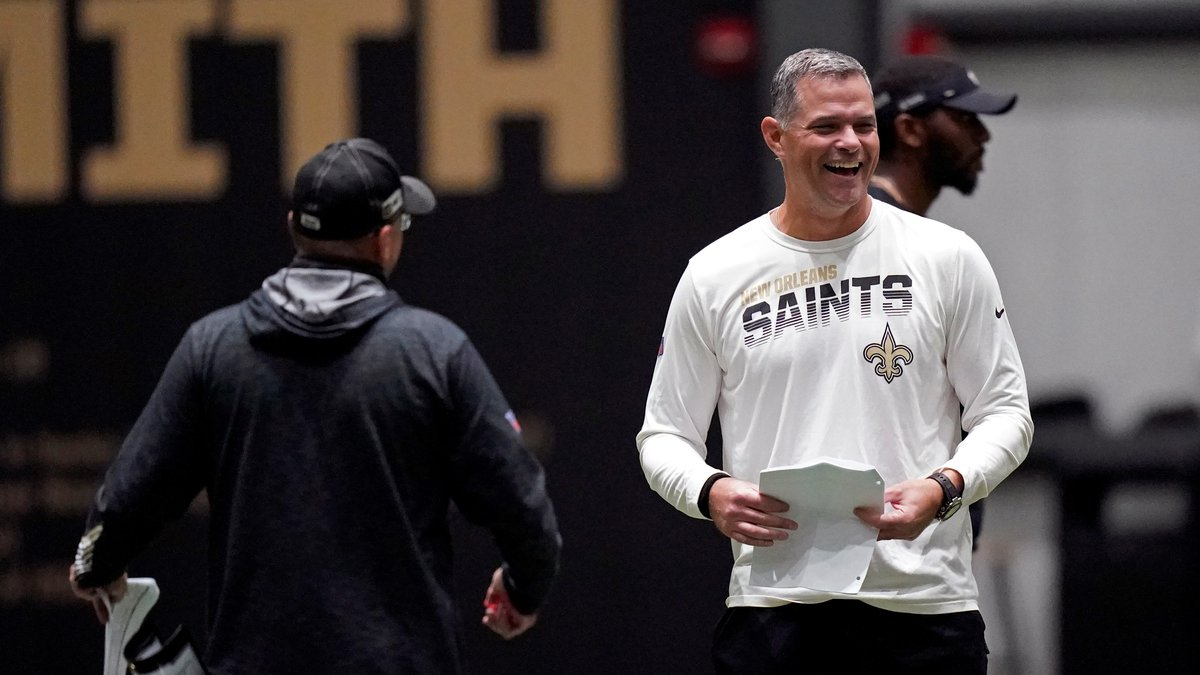 New Orleans Saints quarterbacks coach Joe Lombardi, right, laughs with offensive coordinator...