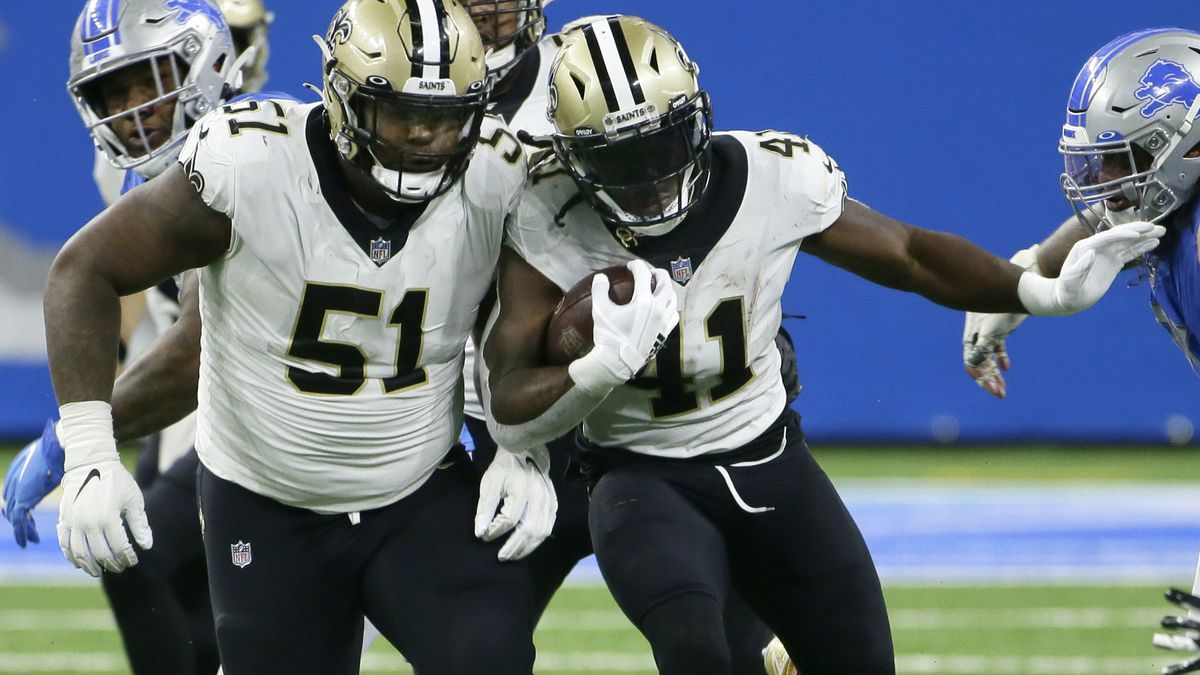 New Orleans Saints center Cesar Ruiz (51) helps make an opening for running back Alvin Kamara (41) against the Detroit Lions during the second half of an NFL football game, Sunday, Oct. 4, 2020, in Detroit. (AP Photo/Duane Burleson)