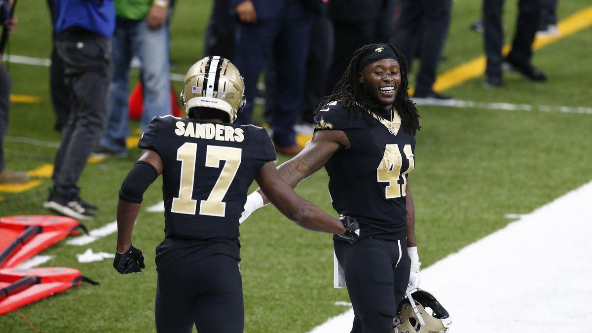 New Orleans Saints running back Alvin Kamara (41) greets wide receiver Emmanuel Sanders (17)...