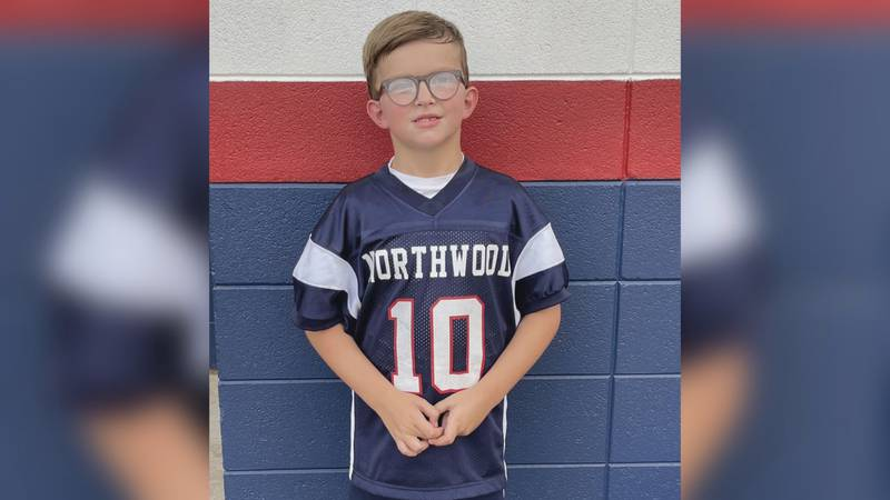 Thomas Moore wearing Northwood jersey, supporting his father and the Gators.