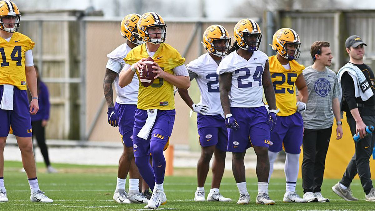 LSU quarterback Myles Brennan prepares to throw a pass during spring practice in March. The players are allowed to do strength and conditioning work only, as football activities are not permitted under the watch of the LSU coaching staff. (Source: Josh Auzenne/WAFB-TV)