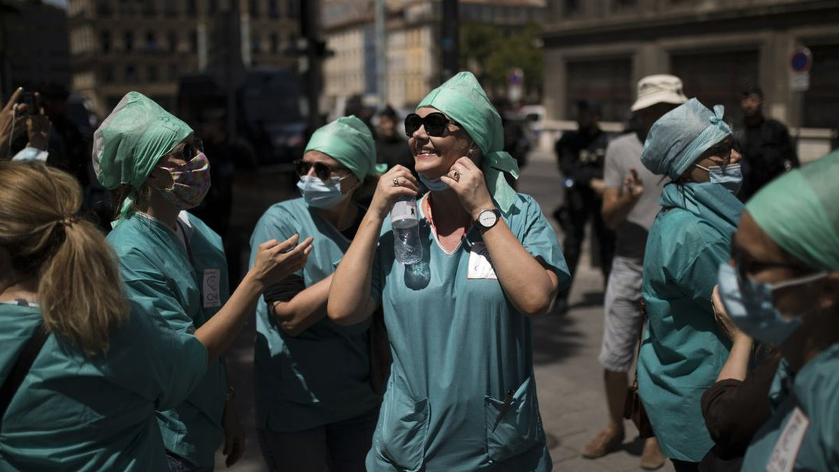 Medical workers attend a demonstration in Marseille, southern France, Tuesday, June 16, 2020....