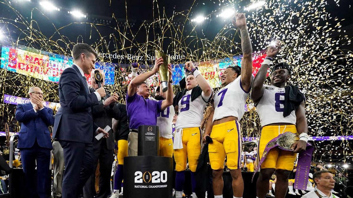 LSU head coach Ed Orgeron holds the trophy after their win against Clemson in a NCAA College Football Playoff national championship game Monday, Jan. 13, 2020, in New Orleans. LSU won 42-25.| Source: AP Photo / David J. Phillip