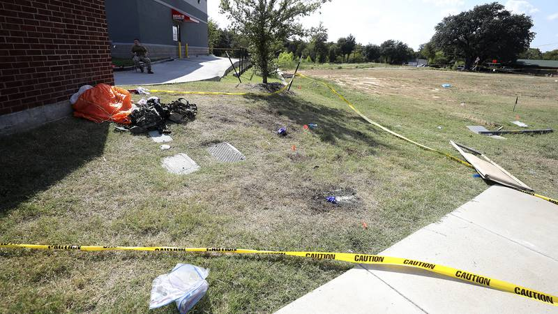 A parachute and other items remain outside an Ole Donut where one pilot landed after ejecting...