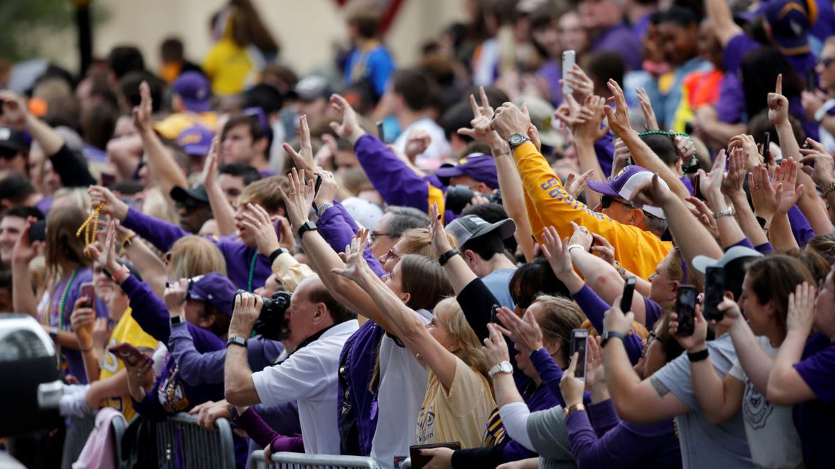 Fans cheer during a parade celebrating their NCAA college football championship, Saturday, Jan. 18, 2020, on the LSU campus in Baton Rouge, La.