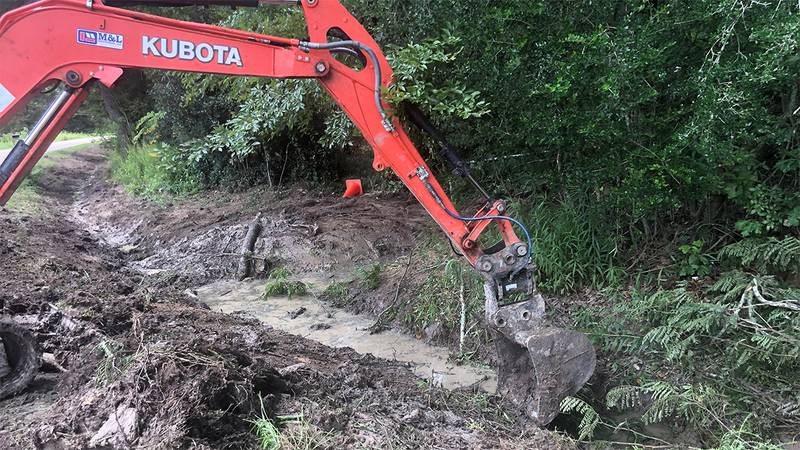 Crews in Baton Rouge cleared ditches and sewers on August 26, 2021 in preparation for possible...