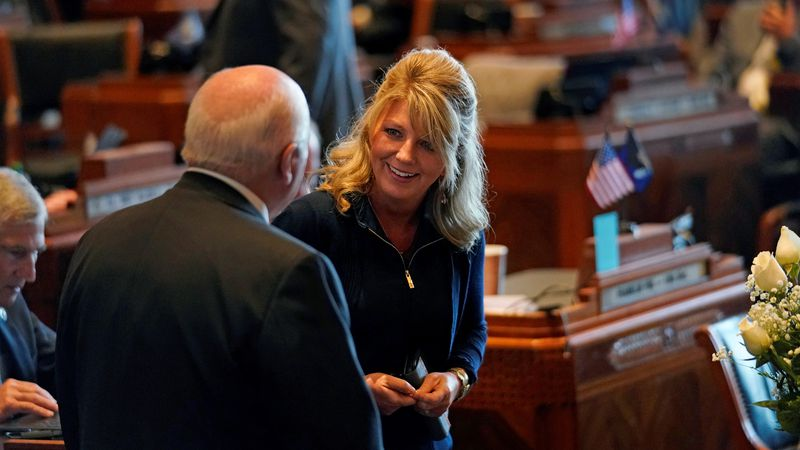 Sen. Heather Cloud, R-Turkey Creek, and Sen. Body White, R-Central, talk during opening day of...