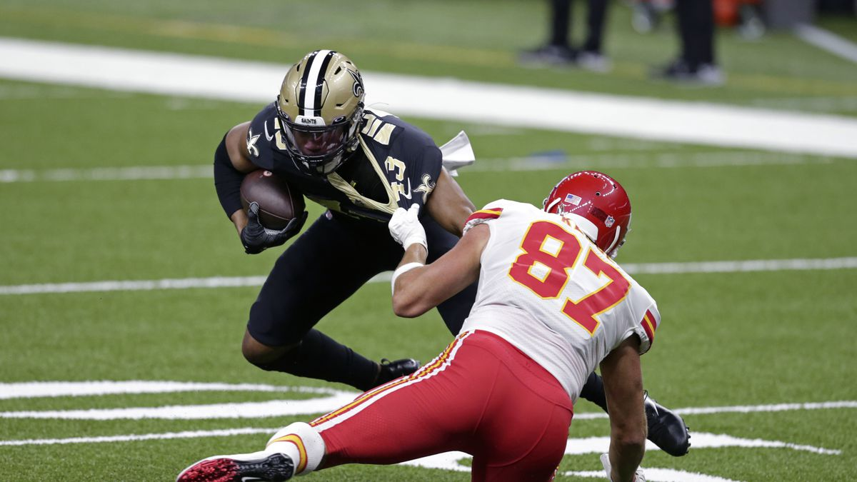Kansas City Chiefs tight end Travis Kelce (87) tries to tackle New Orleans Saints free safety...