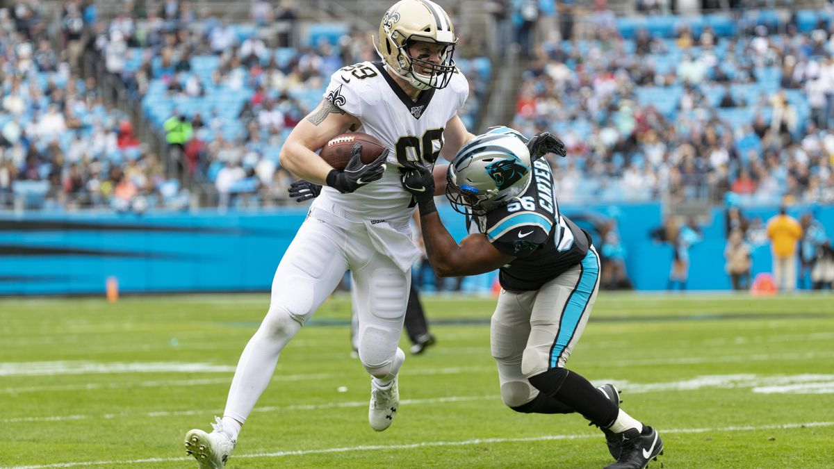 New Orleans Saints tight end Josh Hill (89) avoiding a tackle against Carolina Panthers...