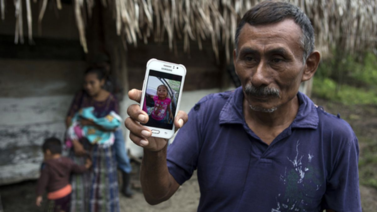 In this Dec. 15, 2018 file photo, Domingo Caal Chub, 61, holds a smartphone displaying a photo...