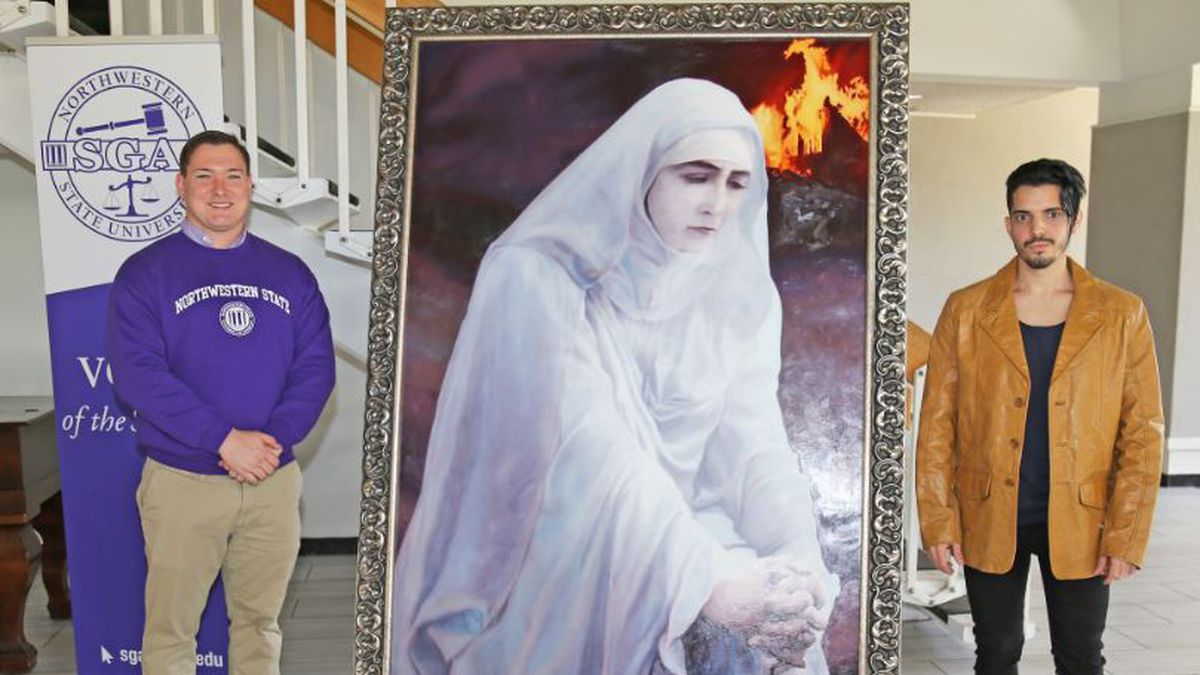 A portrait of Isabella, Northwestern State University's legendary ghost, was unveiled on Halloween Day by SGA President Jacob Ellis, left, and graduate student artist Camilo Mantilla.  The portrait will hang in the Sylvan Friedman Student Union. (NSU)