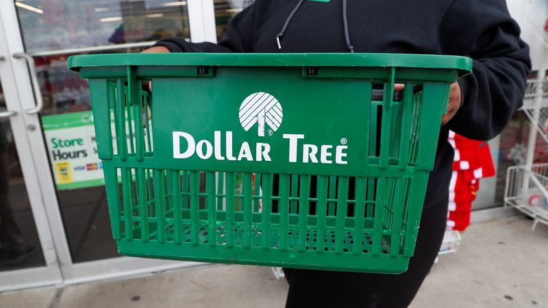 A clerk brings in a shopping basket at a Dollar Tree store in Richland, Miss., Tuesday, Nov....