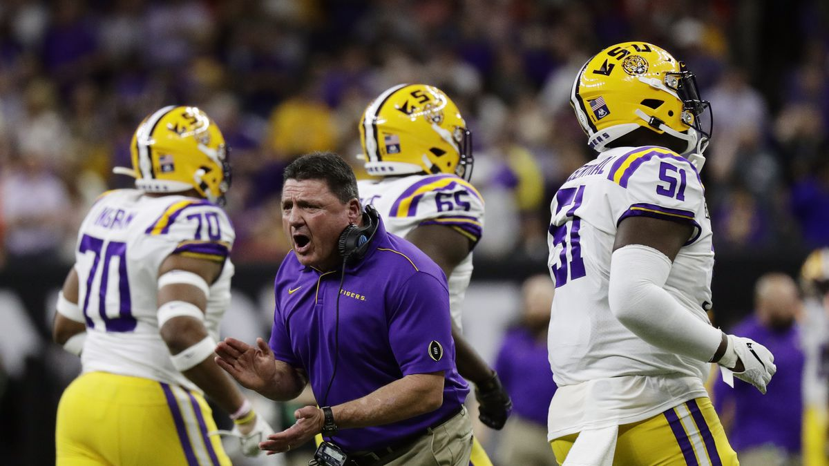 LSU head coach Ed Orgeron cheers during the first half of a NCAA College Football Playoff...