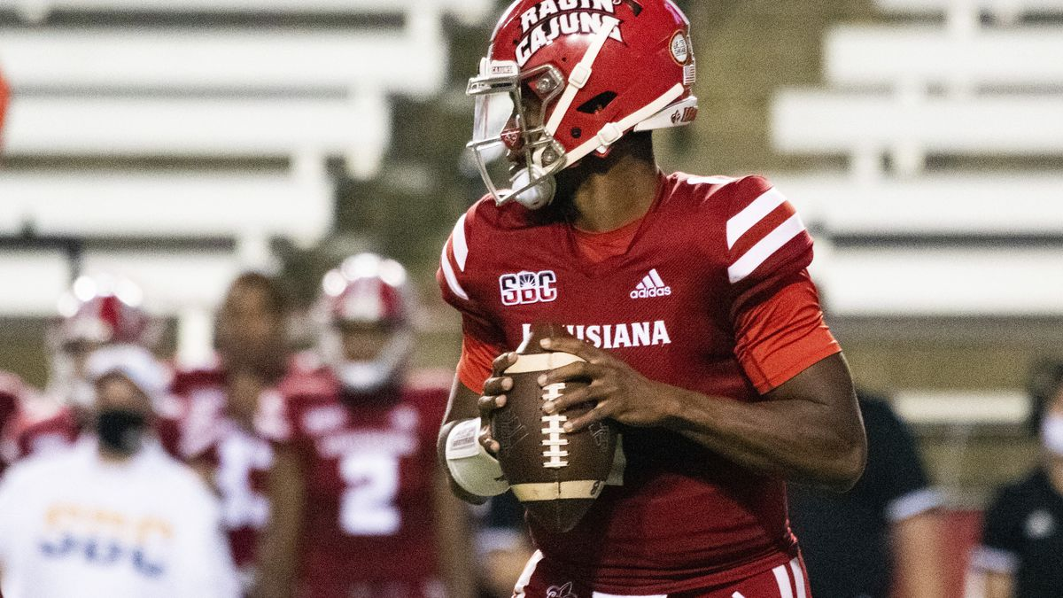 Louisiana-Lafayette quarterback Levi Lewis (1) drops back to attempt a pass during an NCAA game...