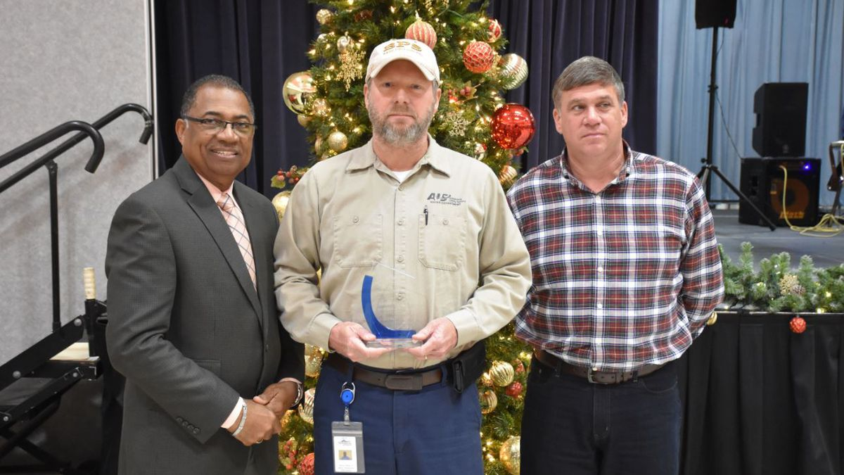 Ronny Pfeifer Jr., Alexandria Water Production Department, accepts his 30-year service award from Mayor Jeff Hall (left) and Alexandria Utility Systems Director Michael Marcotte (right) during the City of Alexandria Service Award Luncheon on Thursday, Dec. 5, in Convention Hall. |  Provided Courtesy of Cynthia D. Jardon