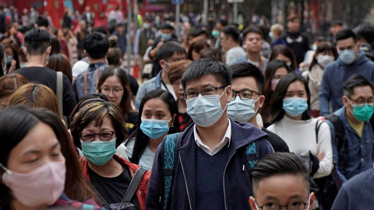 People wear masks on a street in Hong Kong, Friday, Jan. 24, 2020 to celebrate the Lunar New...