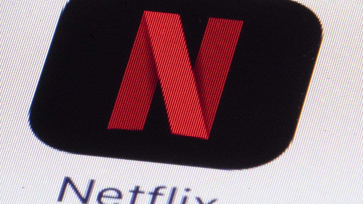 FILE - This Monday, July 17, 2017, file photo shows the Netflix logo on an iPhone in...