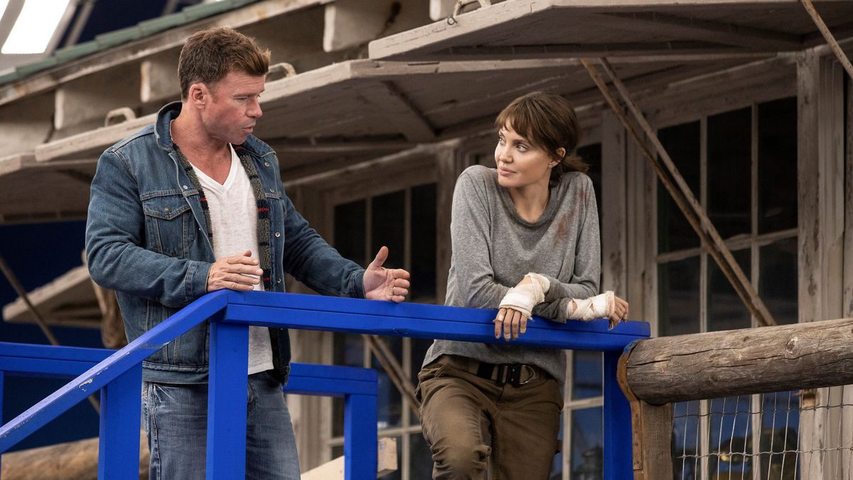 This image released by Warner Bros. Entertainment shows director Taylor Sheridan, left, with...