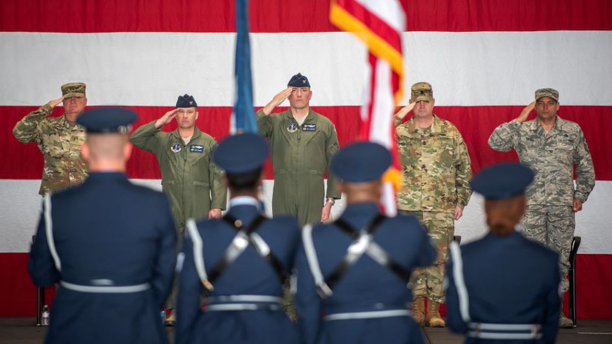 """Leaders from the Louisiana National Guard """"present arms"""" during the playing of the national anthem at the 159th Fighter Wing's change of command ceremony at Naval Air Station Joint Reserve Base New Orleans, March 9, 2019. Col. Matthew G. Rippen, former 159th Maintenance Group commander, assumed command of the 159th Fighter Wing from Col. Shawn M. Coco. (U.S. Air National Guard photo by Senior Master Sgt. Dan Farrell)"""