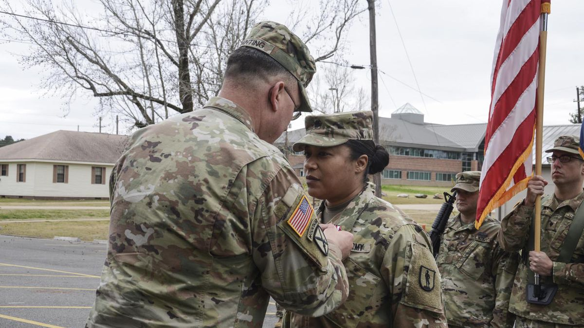 Brig. Gen. Rodney Painting, assistant adjutant general of the Louisiana National Guard, pins a Meritorious Service Medal on Lt. Col. Katrina Lloyd, of Alexandria, Louisiana, during an official change of command ceremony at Camp Beauregard in Pineville, Louisiana, Jan. 13, 2019. During the ceremony, Lloyd relinquished command of 2nd Battalion, 199th Regiment to Lt. Col. Jacques Comeaux, of New Iberia, Louisiana. (U.S. Army National Guard photo by Sgt. Noshoba Davis)
