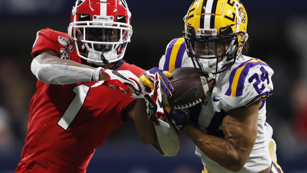 FILE - In this Dec. 7, 2019, file photo, LSU cornerback Derek Stingley Jr. (24) intercepts the ball from Georgia wide receiver George Pickens (1) during the second half of the Southeastern Conference championship NCAA college football game in Atlanta.
