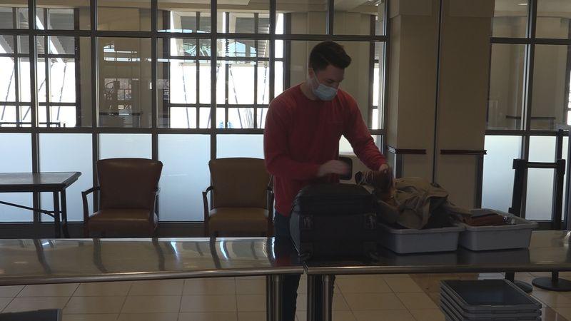 Traveler passing through TSA at Alexandria International Airport.