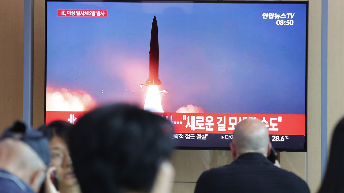 "People watch a TV showing a file image of a North Korea's missile launch during a news program at the Seoul Railway Station in Seoul, South Korea, Tuesday, Aug. 6, 2019. North Korea on Tuesday continued to ramp up its weapons demonstrations by firing unidentified projectiles twice into the sea while lashing out at the United States and South Korea for continuing their joint military exercises that the North says could derail fragile nuclear diplomacy. The sign reads ""North Korea could seek a new road."" 