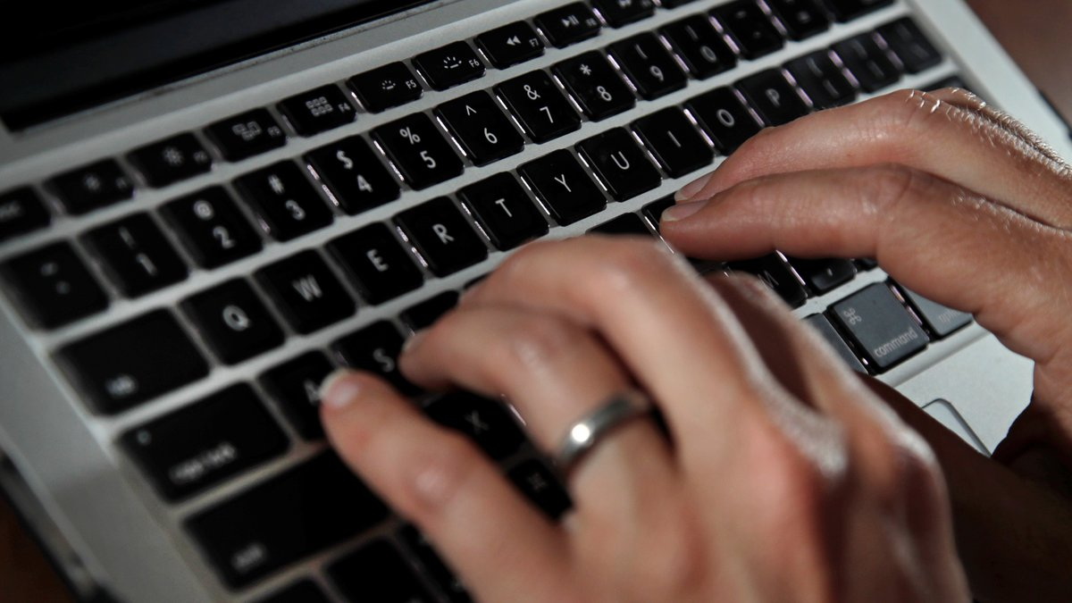 Fingers type on a laptop keyboard Monday, June 19, 2017, in North Andover, Mass.