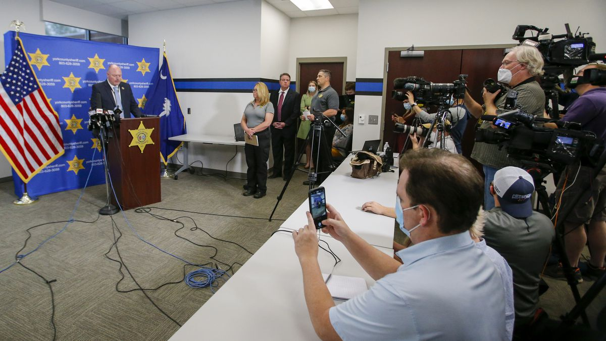 York County Sheriff Kevin Tolson reads a statement from the victims' families during a press...