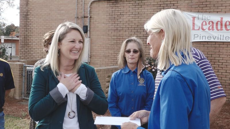 The Pineville Rotary Club presented funds to Pineville Elementary for the Club's school closet...